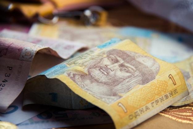 Национальный банк повысилофициальный курс гривны на 1 копейку до 26,48/$.