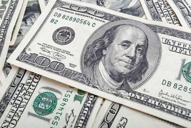 Доллар к открытию межбанка подешевел
